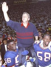 Bill Parcells is carried off the field by linebackers Lawrence Taylor and Carl Banks (Yahoo Sports)