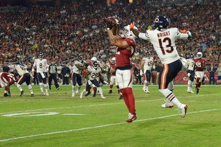 Aug 19, 2017; Glendale, AZ, USA; Arizona Cardinals free safety Tyrann Mathieu (32) intercepts a pass intended for Chicago Bears wide receiver Kendall Wright (13) during the first half at University of Phoenix Stadium. Mandatory Credit: Joe Camporeale-USA TODAY Sports