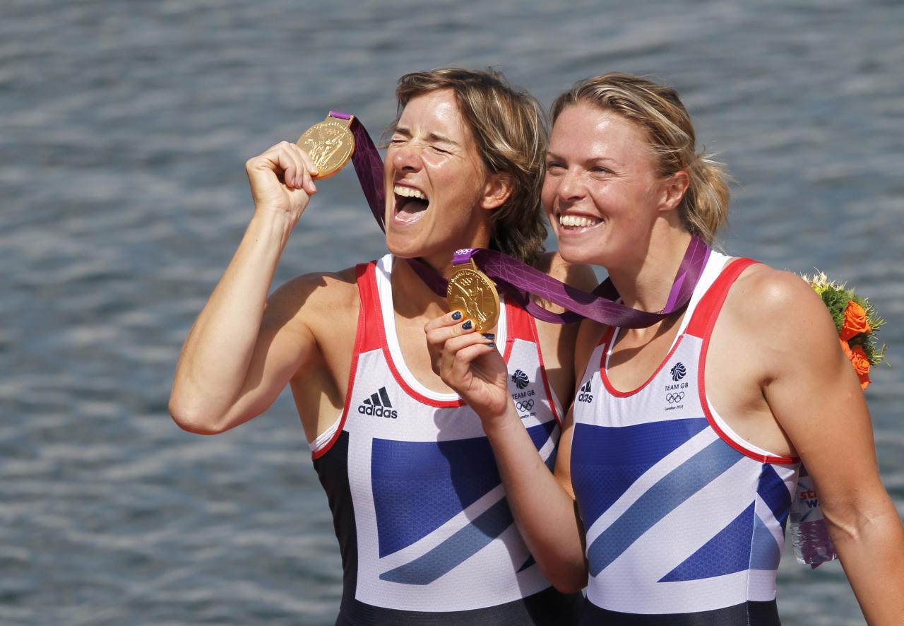 Gold medallists Britain's Katherine Grainger and Anna Watkins (L) celebrate with their medals during the awards ceremony for the women's double sculls at the London 2012 Olympic Games in Eton Dorney August 3, 2012.                               REUTERS/Mark Blinch (BRITAIN  - Tags: OLYMPICS SPORT ROWING)