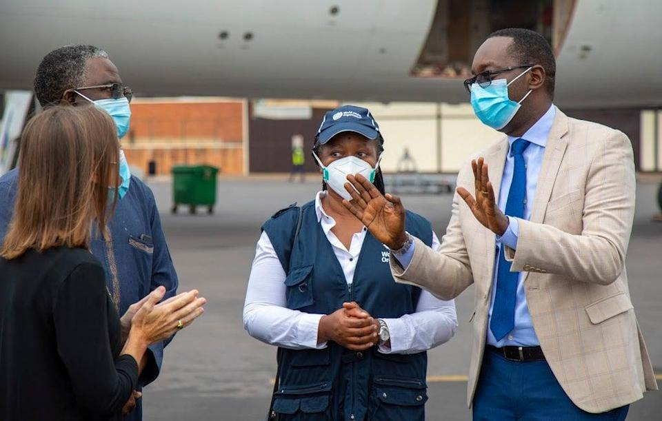 Rwanda's Health Minister Dr Daniel Ngamije (right)  as vaccines arrive in Kigali in March (WHO/Andre Rugema)