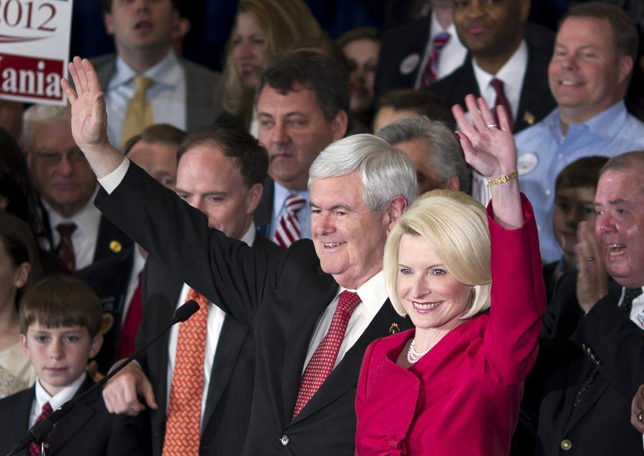 Republican presidential candidate, former House Speaker Newt Gingrich, left, and his wife Callista wave as they arrive for a Super Tuesday rally on Tuesday, March 6, 2012 in Atlanta. (AP Photo/Evan Vucci)
