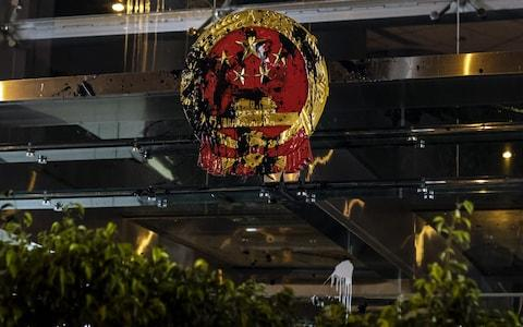 The Liaison Office's Chinese emblem was defaced - Credit: Bloomberg
