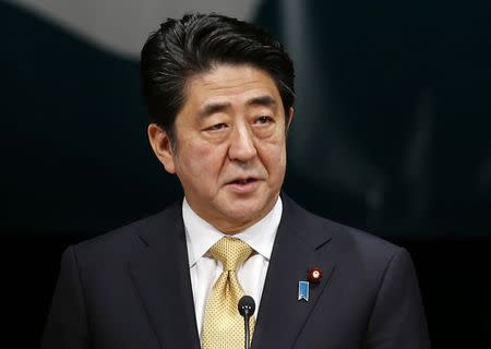 Japan's Prime Minister Abe speaks during a Northern Territories Day rally to call on Russia to return a group of islands, known as the Northern Territories in Japan and the Southern Kuriles in Russia, in Tokyo