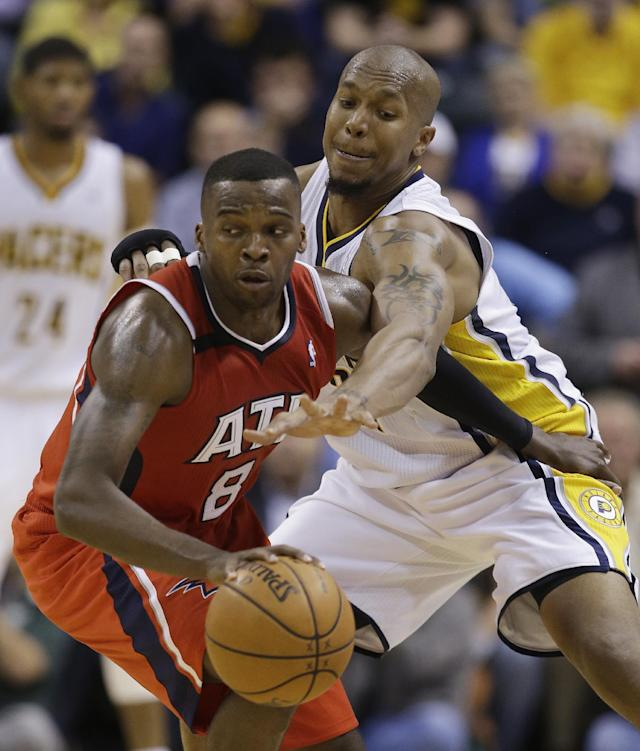 Atlanta Hawks' Shelvin Mack (8) is defended by Indiana Pacers' David West (21) during the second half in Game 5 of an opening-round NBA basketball playoff series Monday, April 28, 2014, in Indianapolis. Atlanta defeated Indiana 107-97. (AP Photo/Darron Cummings)
