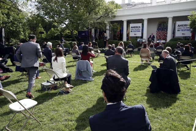 The clash took place during a coronavirus briefing in the White House Rose Garden (Alex Brandon/AP)