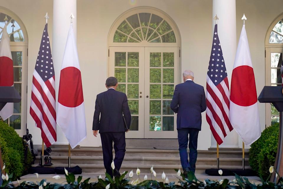 President Joe Biden and Japanese Prime Minister Yoshihide Suga leave after a news conference in the Rose Garden of the White House, Friday, April 16, 2021, in Washington.