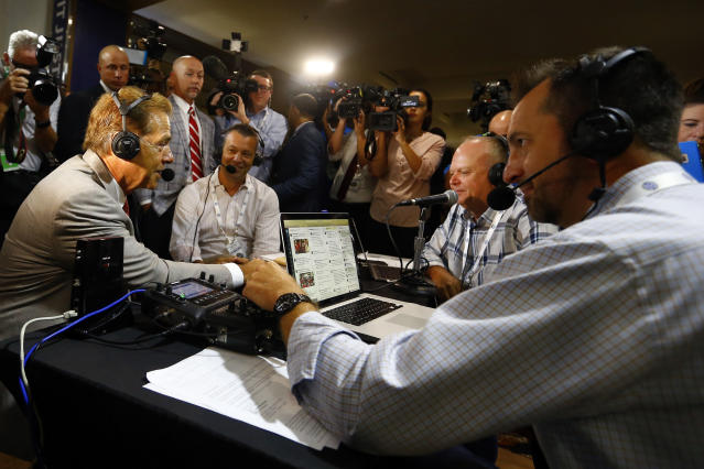 Alabama head coach Nick Saban, left, visits Radio Row during the NCAA college football Southeastern Conference Media Days, Wednesday, July 17, 2019, in Hoover, Ala. (AP Photo/Butch Dill)