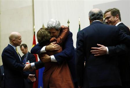 U.S. Secretary of State John Kerry (3rd R) hugs European Union foreign policy chief Catherine Ashton after she delivered a statement during a ceremony next to British Foreign Secretary William Hague (L), Germany's Foreign Minister Guido Westerwelle (R) and French Foreign Affairs Minister Laurent Fabius at the United Nations in Geneva November 24, 2013. REUTERS/Denis Balibouse/Files