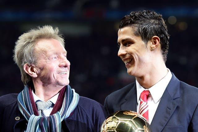Manchester United great Denis Law in conversation with Cristiano Ronaldo