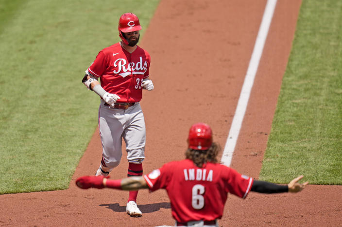 Cincinnati Reds' Jesse Winker, top, arrives home after hitting a two-run home run as teammate Jonathan India (6) celebrates during the second inning of a baseball game Sunday, June 6, 2021, in St. Louis. (AP Photo/Jeff Roberson)