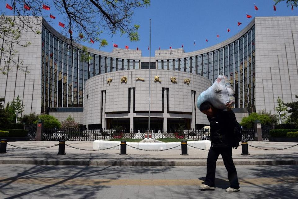 The People's Bank of China has cut interest rates three times since November 2014 and twice reduced the amount of cash banks must keep in reserve, along with other measures to inject liquidity into the market (AFP Photo/Mark Ralston)