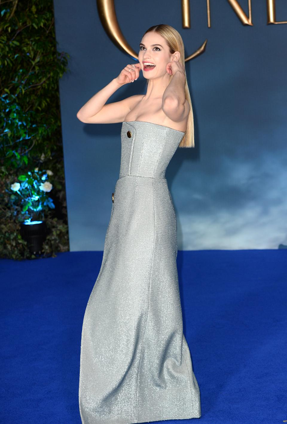 Lily James attends the UK Premiere of Disney's Cinderella held at the Odeon cinema in Leicester Square, London