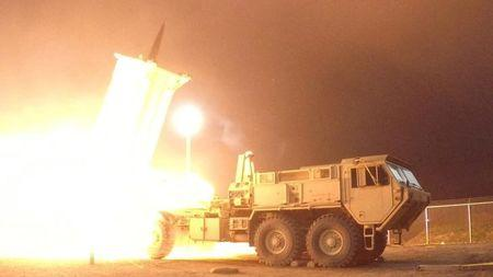 FILE PHOTO - A Terminal High Altitude Area Defense (THAAD) interceptor is launched from the Pacific Spaceport Complex Alaska during Flight Experiment THAAD (FET)-01 in Kodiak, Alaska, U.S. on July 30, 2017. Picture taken on July 30, 2017.    Courtesy Leah Garton/Missile Defense Agency/Handout via REUTERS