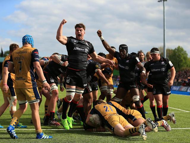 Saracens celebrate after driving Petrus du Plessis over the line for one of his two tries: Getty