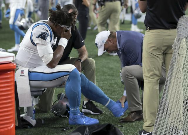 Panthers quarterback Cam Newton ditched his walking boot on Sunday. (AP Photo/Charles Krupa)