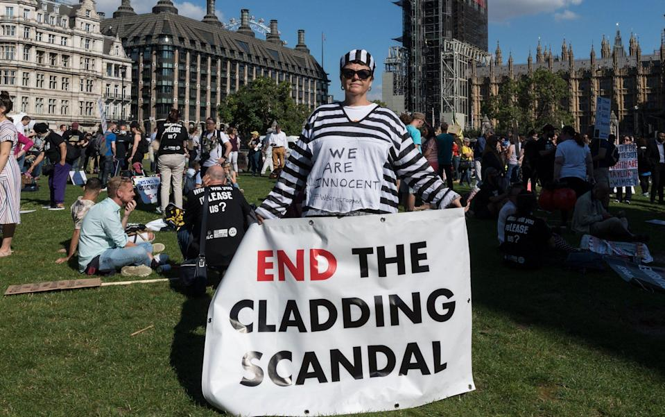Members of leasehold action groups stage a rally in Parliament Square protesting against cost of ground rents, building safety, cladding and call for abolition of leasehold law across England and Wales on September 16, 2021 in London, England - Barcroft Media