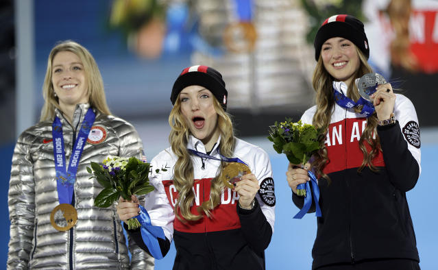 Women's moguls medalists from left, Hannah Kearney of the United States, bronze, Canada's Justine Dufour-Lapointe, gold, and her sister silver medalist Chloe Dufour-Lapointe pose during their medal ceremony at the 2014 Winter Olympics, Sunday, Feb. 9, 2014, in Sochi, Russia. (AP Photo/David Goldman)