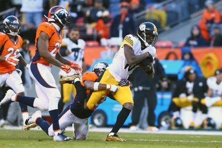Jan 17, 2016; Denver, CO, USA; Pittsburgh Steelers wide receiver Martavis Bryant (10) is brought down by Denver Broncos strong safety T.J. Ward (43) during the third quarter of the AFC Divisional round playoff game at Sports Authority Field at Mile High. Mandatory Credit: Mark J. Rebilas-USA TODAY Sports / Reuters Picture Supplied by Action Images