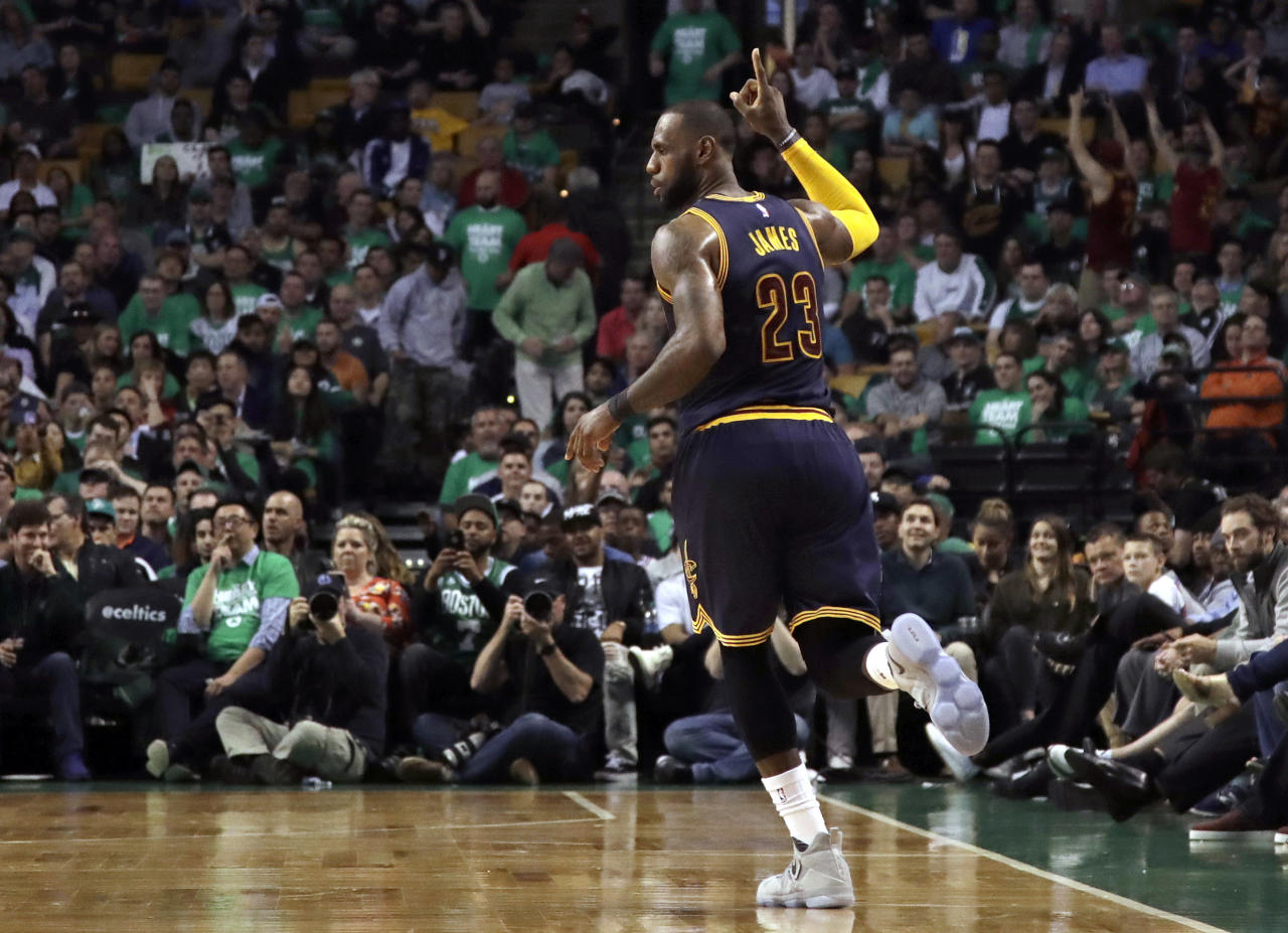 Cleveland Cavaliers forward LeBron James celebrates after sinking a three point shot during the second half of Game 5 of the NBA basketball Eastern Conference finals against the Boston Celtics, on Thursday, May 25, 2017, in Boston. (AP Photo/Elise Amendola)