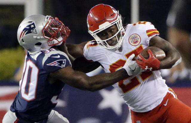 <p>Kansas City Chiefs running back Kareem Hunt (27) gives a stiff arm to New England Patriots safety Duron Harmon (30) during the first half of an NFL football game, Thursday, Sept. 7, 2017, in Foxborough, Mass. (AP Photo/Steven Senne) </p>