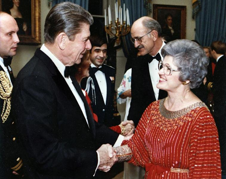 In this 1983 White House photo President Ronald Reagan greets newly elected U.S. Rep. Barbara Vucanovich, and her husband, George Vucanovich on their first White House dinner honoring new members of Congress in the White House in Washington. Barbara Vucanovich, who was the first woman to represent Nevada in Congress and went on to serve the sprawling, rural 2nd Congressional District for 14 years, died Monday, June 10, 2013 after a short illness, family members said. She was 91. (AP Photo/White House)