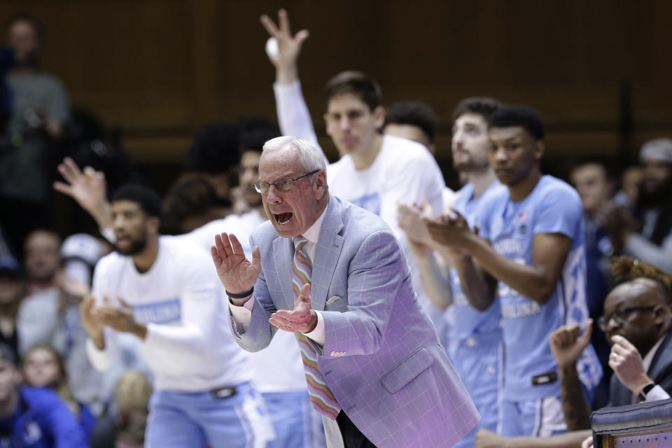 FILE - In this March 7, 2020, file photo, North Carolina coach Roy Williams applauds during the second half of the team's NCAA college basketball game against Duke in Durham, N.C. North Carolina announced Thursday, April 1, 2021, that Hall of Fame basketball coach Roy Williams is retiring after a 33-year career that includes three national championships. (AP Photo/Gerry Broome, File)
