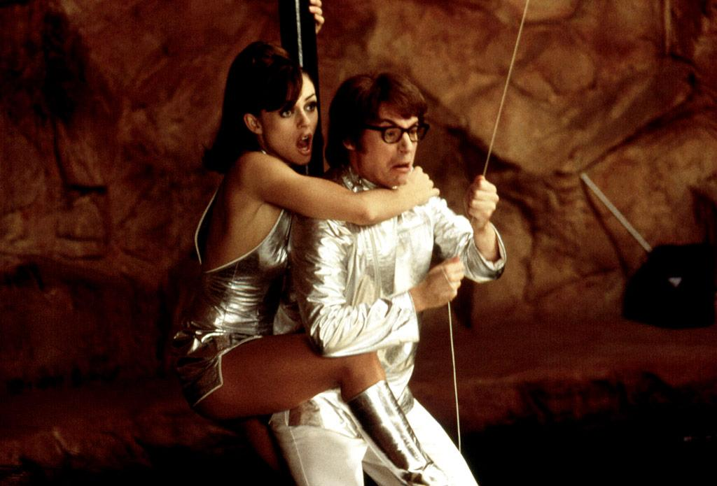 "He had the worst pick-up lines ever and one of the cheesiest wardrobes in cinema history, yet somehow Mike Myers' ""Austin Powers: International Man of Mystery"" ended up with the girl in this 1997 comedy. And he fell in love with not just any girl, but a bright, leggy looker (played by Elizabeth Hurley) willing to help the '60s spy stop Dr. Evil from taking over the world. Only in the movies! Courtesy Everett Collection"