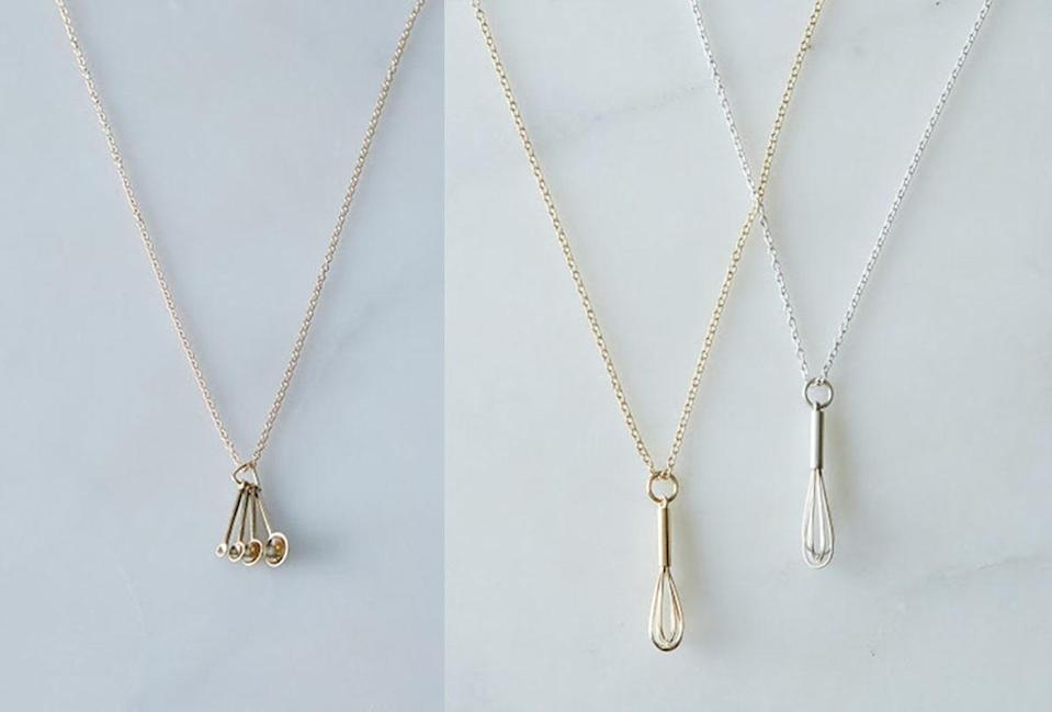 """<p>These delicate tributes to the kitchen will delight every cook, from those who've tried their hand at baking a simple dessert to those who have mastered the soufflé. They are handmade, come on a small cable chain, and are available in sterling silver and 14k gold. <b>Price: $66 to $325. Get the <a href=""""http://www.dpbolvw.net/click-7941319-12380826-1447099890000?url=http%3A%2F%2Ffood52.com%2Fshop%2Fproducts%2F811-whisk-necklace%3Fsku%3Dsilver&cjsku=811_silver"""" rel=""""nofollow noopener"""" target=""""_blank"""" data-ylk=""""slk:whisk necklace"""" class=""""link rapid-noclick-resp"""">whisk necklace</a> or the <a href=""""https://food52.com/shop/products/2202-measuring-spoons-necklace?sku=silver&affil=cj&utm_source=cj&utm_medium=affiliate&utm_campaign=Product+Catalog"""" rel=""""nofollow noopener"""" target=""""_blank"""" data-ylk=""""slk:measuring spoon necklace"""" class=""""link rapid-noclick-resp"""">measuring spoon necklace</a>. </b><i>(Photo: Food 52)</i></p>"""