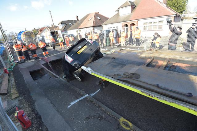 The car was pulled from the sinkhole on Monday. (PA)