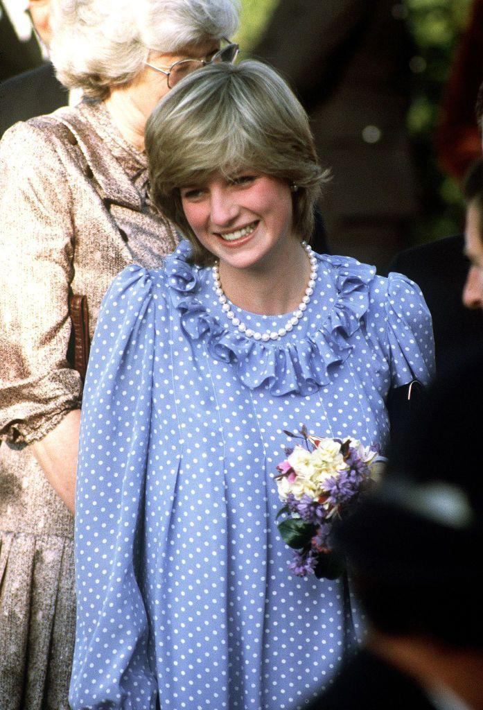 <p>A pregnant Princess of Wales visits the Isles of Scilly, April 1982. She is wearing a maternity dress by Catherine Walker that has a ruffle neck collar which she paired with pearls.</p>