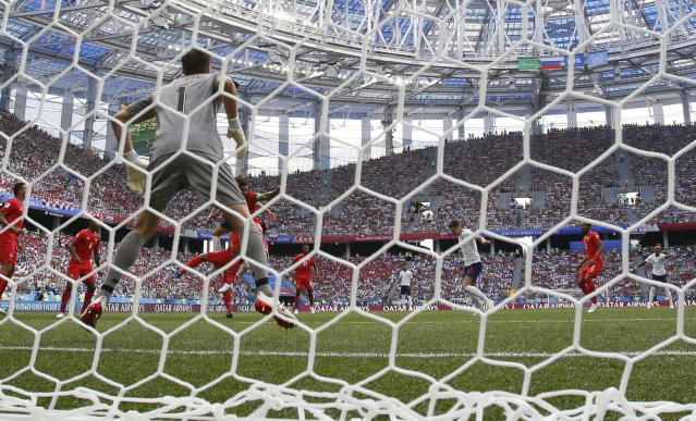 <p>England's John Stones scores his side's opening goal during the group G match </p>