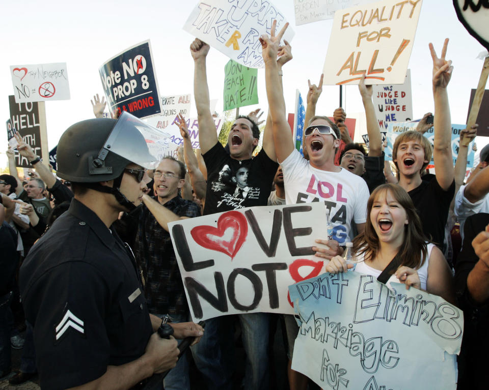 Protesters wait at a police skirmish line before being allowed to proceed as hundreds demonstrated against the Mormon Church's support of Proposition 8, the California ballot measure that banned same-sex marriage, in the Westwood district of Los Angeles Thursday, Nov. 6, 2008. Prop 8 was overturned in 2013. (AP Photo/Reed Saxon)