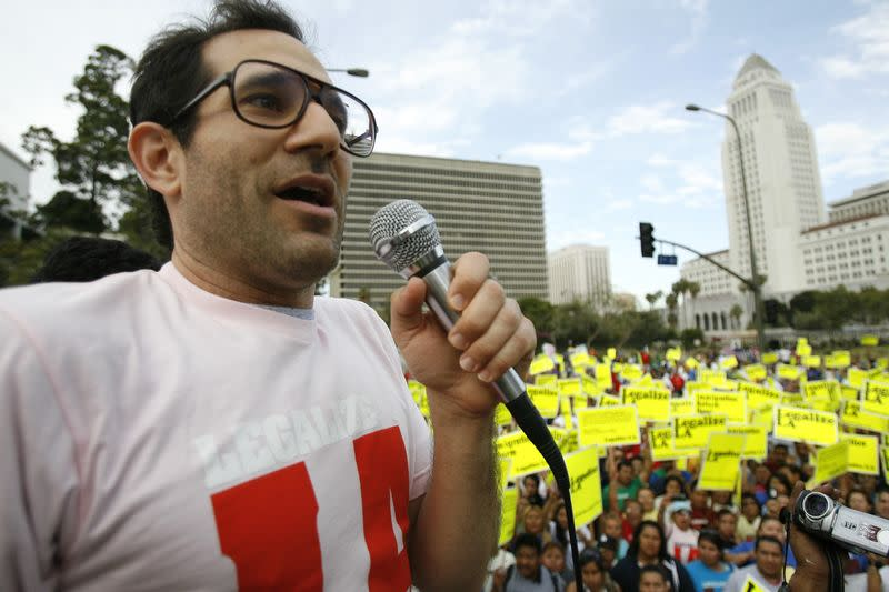 American Apparel owner Dov Charney speaks during a May Day rally in downtown Los Angeles