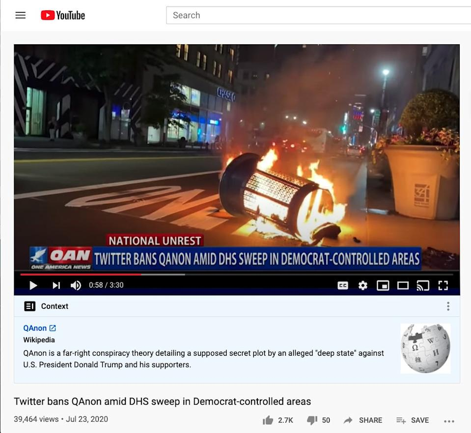 "A ""context"" panel beneath a One America News Network video about QAnon leads readers to the conspiracy theory's Wikipedia page for more information."