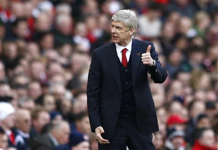 Arsenal's manager Arsene Wenger gestures during their English Premier League soccer match against Sunderland at the Emirates Stadium in London, February 22, 2014. REUTERS/Darren Staples