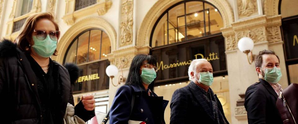 MILANO,ITALY- FEBRUARY 22, 2020: Coronavirus in Italy.Protective mask.Tourists in face masks at the Wiktor Emanuel II Gallery