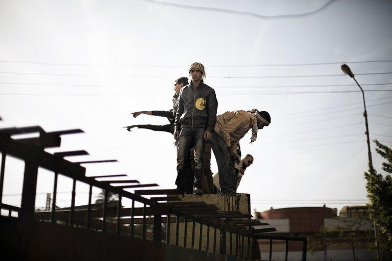 Protesters opposed to Egypt's Islamist president demonstrate on top of a barricade erected by the Egyptian army