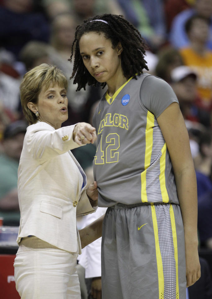 Baylor coach Kim Mulkey talks with center Brittney Griner during the second half of an NCAA women's college basketball tournament regional final against Tennessee, Monday, March 26, 2012, in Des Moines, Iowa. (AP Photo/Charlie Neibergall)