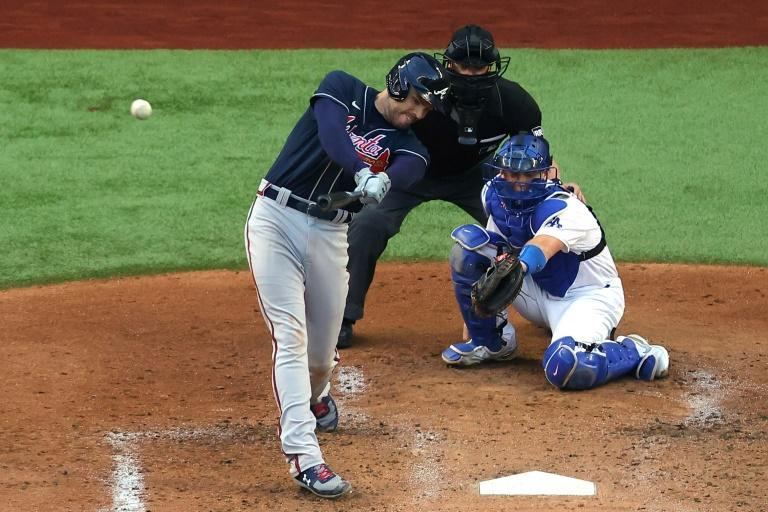 Atlanta first baseman Freddie Freeman hits a two-run home run in the fourth inning of the Braves' 8-7 victory over the Los Angeles Dodgers in game two of baseball's National League Championship Series