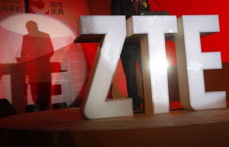 The ZTE company logo is seen as a guest delivers a speech during the company's 15th anniversary celebration in Beijing