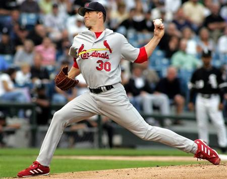 Cardinals Mulder throws to the plate against the White Sox in Chicago