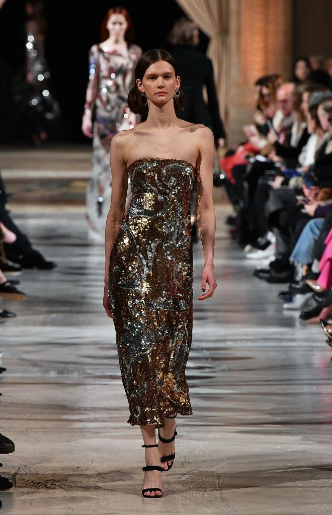 <p>A gold-and-silver strapless sequined dress at the Oscar de la Renta FW18 show. (Photo: Getty) </p>