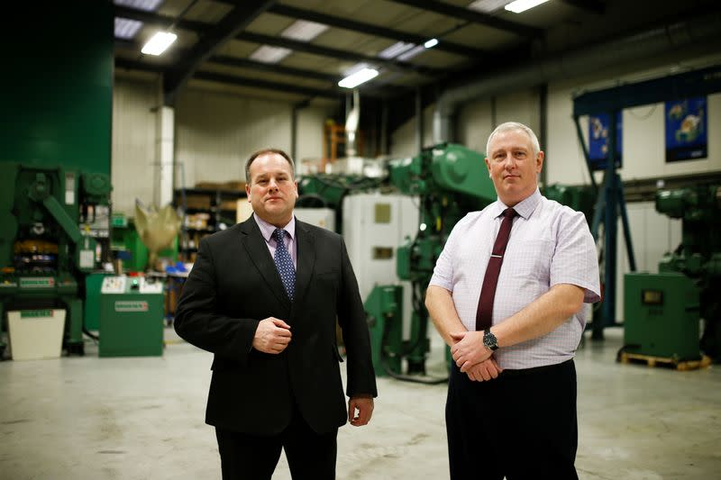 Managing Director of Bruderer Uk Ltd Adrian Haller and Service Manager Mark Crawford pose at the company's factory in Luton
