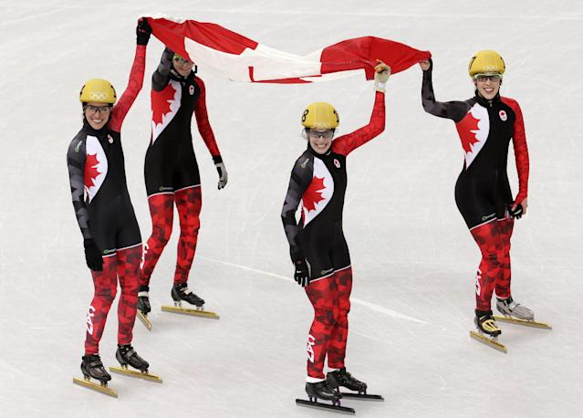 The Canadian team celebrate their second place in the women's 3000m short track speedskating relay final at the Iceberg Skating Palace during the 2014 Winter Olympics, Tuesday, Feb. 18, 2014, in Sochi, Russia. (AP Photo/Bernat Armangue)