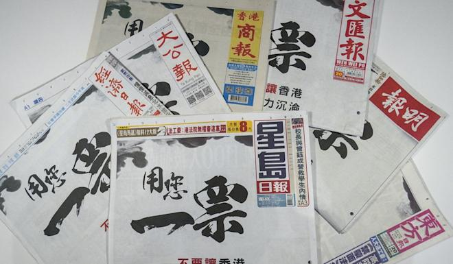 Advertisements in Chinese-language newspapers calling on people to come out and vote. Photo: Roy Issa