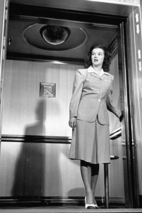 <p>Elevators didn't always move with the simple push of a button. Back in the day, elevator operators were in charge of controlling everything from the doors and direction to the speed and capacity of the elevator car — a lot of layers, or should we say levels, to the position. In the '50s, automatic elevators became more common and individuals had to push their own button (gasp!).</p>