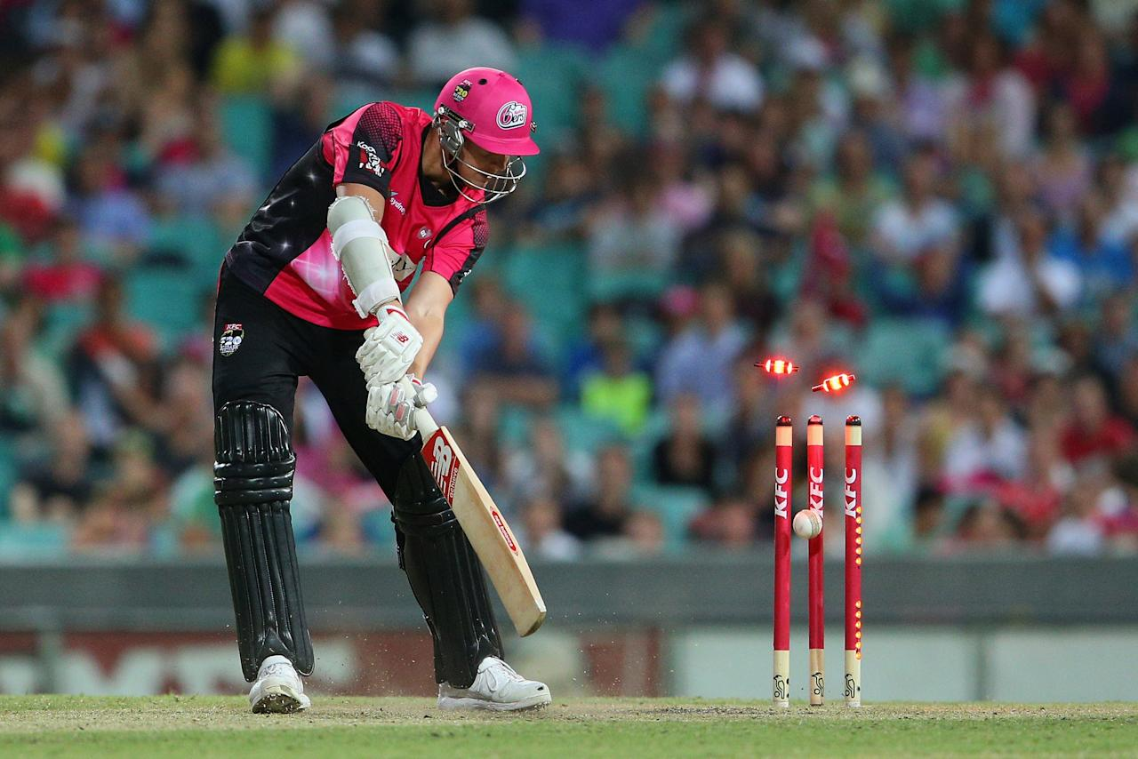 SYDNEY, AUSTRALIA - JANUARY 09: Josh Hazelwood of the Sixers is bowled by Nathan Rimmington of the Renegades during the Big Bash League match between the Sydney Sixers and the Melbourne Renegades at SCG on January 9, 2013 in Sydney, Australia.  (Photo by Cameron Spencer/Getty Images)