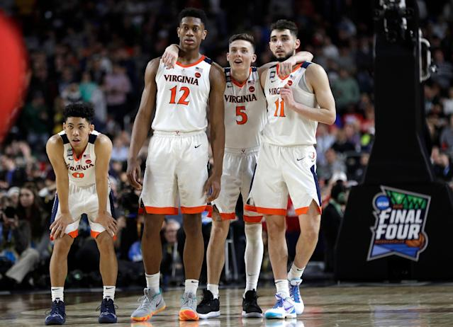 Virginia players Kihei Clark, De'Andre Hunter, Kyle Guy and Ty Jerome celebrate at the end of the championship game against Texas Tech. (AP Photo/David J. Phillip)