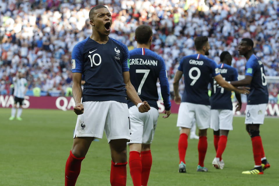 FILE - In this Saturday, June 30, 2018 file photo, France's Kylian Mbappe celebrates after scoring his side's third goal during their round of 16 match against Argentina, at the 2018 soccer World Cup at the Kazan Arena in Kazan, Russia. Kylian Mbappe and Thierry Henry are seemingly linked by destiny. While Henry is France's leading scorer with 51 goals and among the greatest forwards of the modern era, the 19-year-old Mbappe is the new French sensation tipped to become perhaps even the world's best. (AP Photo/David Vincent, file)