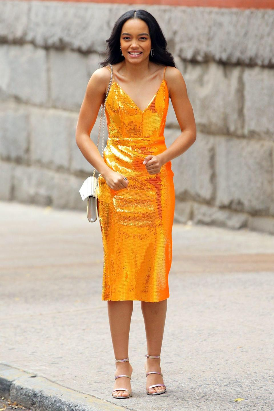 <p>Whitney Peak films a scene for the <i>Gossip Girl</i> reboot in an orange sequin cocktail dress on a chilly Tuesday in N.Y.C. </p>